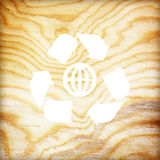 Wooden texture with recycle symbol Royalty Free Stock Photography