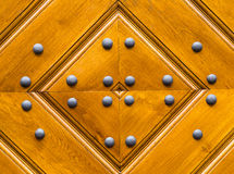 Wooden texture stacked of boards drawing of a diamond with iron rivets Stock Photos