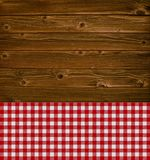 Wooden texture with tablecloth. Wooden planks texture with red white tablecloth Royalty Free Stock Photography