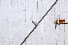 Wooden texture of wooden door and small metallic lock Stock Photo