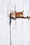 Wooden texture of wooden door and small metallic lock Stock Image