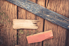 Wooden textured background as old cracked wooden fence with blank wooden directional signs with copy space Stock Images