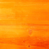Wooden textured background in a rich orange Stock Photo