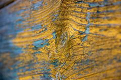 Wooden textured waves background colored yellow and blue stock image