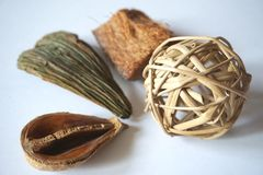 Wooden textures and decoration objects: hulls, bark, straw ball Stock Photos