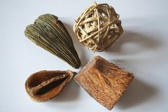 Wooden textures and decoration objects: hulls, bark, straw ball Stock Images