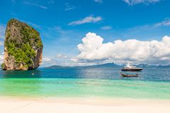 Wooden Thai boat and yacht near the mountain Poda island. Thailand Stock Photos