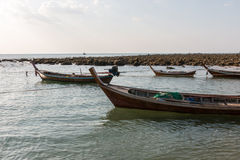 Wooden thai boats attached with rope Royalty Free Stock Photos