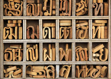 Wooden thai language characters bangkok. Small wooden letters of the thai alphabet sorted by character in compartments in carpenters shop bangkok thailand Royalty Free Stock Photos