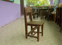 Wooden Thai school chairs Royalty Free Stock Photo