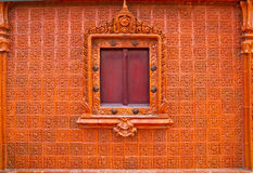 Wooden Thai window on brown tile wall Stock Image