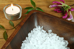 Wooden therapy SPA. Spa resort therapy composition, candle, flower and salt crystals Royalty Free Stock Image