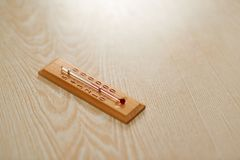 Wooden thermometer with Celsius scale on  table Royalty Free Stock Photos