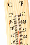 A wooden thermometer close up. Royalty Free Stock Photos