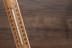 Wooden thermometer on the table Royalty Free Stock Photos
