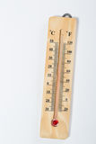 Wooden thermometer on white Stock Photos