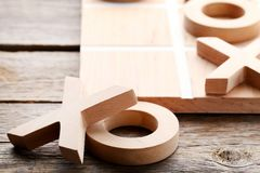 Tic tac toe game. Wooden tic tac toe game on grey table Royalty Free Stock Photography
