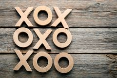 Tic tac toe game. Wooden tic tac toe game on grey table Stock Image