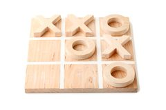 Tic tac toe game. Wooden tic tac toe game isolated on white Royalty Free Stock Photo