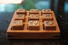 Wooden tic tac toe game royalty free stock images