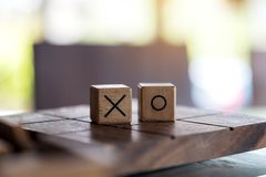 Wooden Tic Tac Toe game or OX game in a box. Closeup image of wooden Tic Tac Toe game or OX game in a box Stock Photo