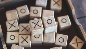 Wooden Tic Tac Toe game or OX game in a box. Closeup image of wooden Tic Tac Toe game or OX game in a box Stock Image