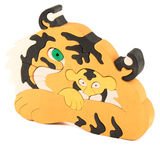 Wooden tiger puzzle toy Stock Photos