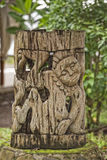 Wooden tiki on tropical paradise beach. With coconut trees Royalty Free Stock Images