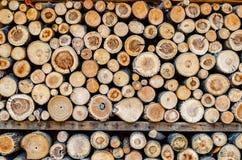 Wooden tile background; chopped cut wood, winter fire.