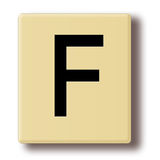 Wooden tile with the letter F Stock Photos