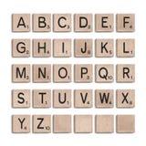 Wooden tiles alphabet 3d realistic letters. Vector illustration. Wooden tiles alphabet 3d realistic letters. Word puzzling board game design elements set vector illustration