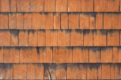 Wooden tiles country house facade. Surface closeup as background Royalty Free Stock Images
