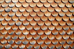 Wooden tiles on house in austrian alps Royalty Free Stock Images