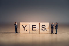 Wooden tiles with letters spelling out the word Yes. Business concept.  royalty free stock image