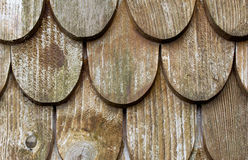 Wooden tiles on the roof of a house Stock Photos