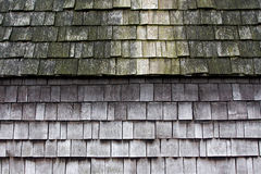 Wooden tiles on the roof of old  house Stock Images