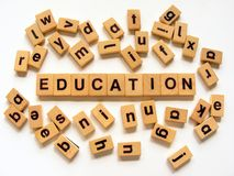 Wooden tiles spelling out Education Stock Photos