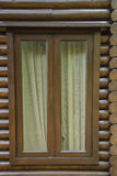 Wooden timber log house window stock photo