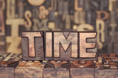 Wooden TIME concept Stock Images