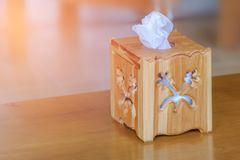 Wooden tissue paper box. On wooden table with blurry background Royalty Free Stock Photography