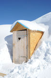 Wooden toilet box in the middle of snow Stock Image