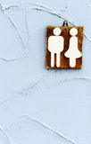 Wooden toilet sign. On the bule wall Stock Image