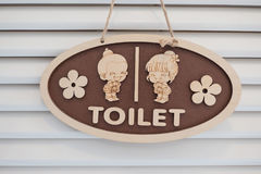 Wooden toilet sign , Cute boy and girl on White background.  Stock Photography