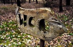 Wooden toilet sign in the forest. stock photos