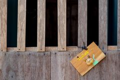 Wooden toilet sign hanging on the wooden door. royalty free stock photo