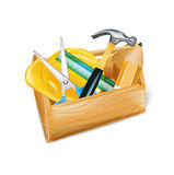 Wooden tool box with hard hat, hammer, ruler, and scissors isola Stock Images