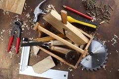 Carpenter`s tools. Wooden tool box at work place Stock Photos