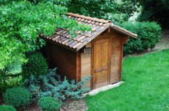 Wooden tool shed. Wooden garden tool shed in a beautiful park Stock Photo