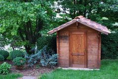 Wooden tool shed. Wooden garden tool shed in a beautiful park Stock Image