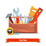 Wooden toolbox full of equipment Royalty Free Stock Photos